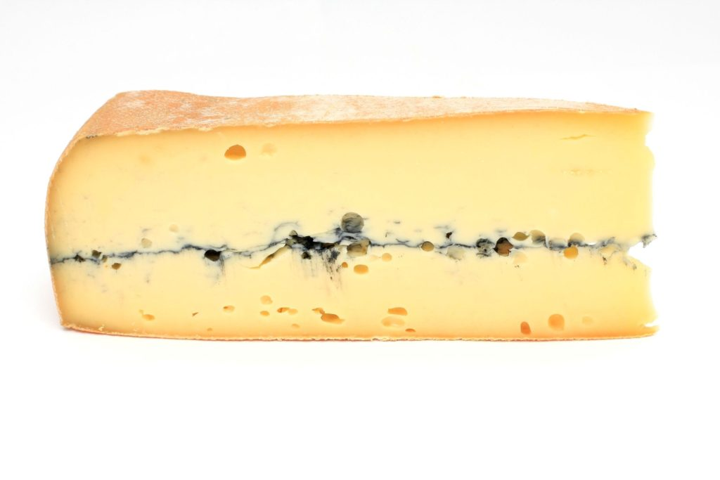 slice of french cheese, morbier variety